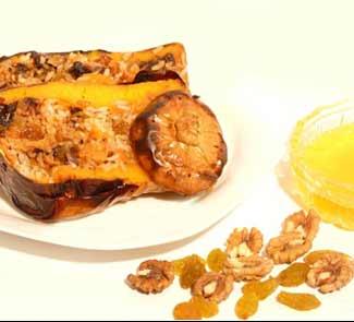Рецепт Тыква запеченная с рисом, сухофруктами, орехами и политая мёдом.